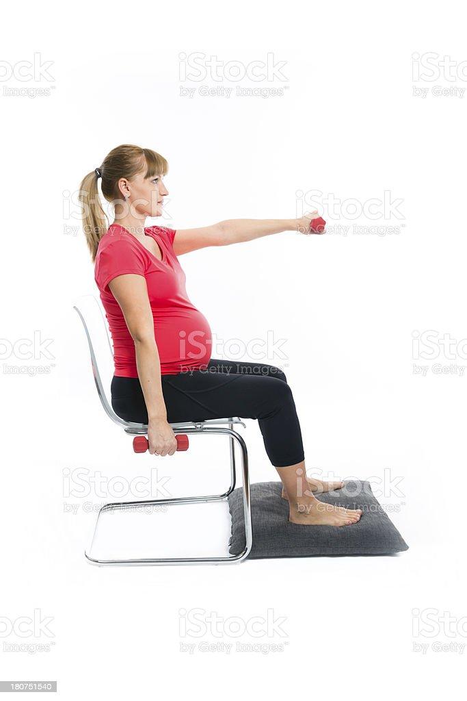 Beautiful pregnant woman doing exercises royalty-free stock photo
