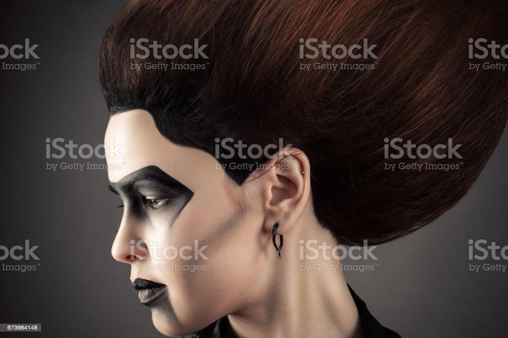 beautiful profile face woman with dark fashion make-up stock photo