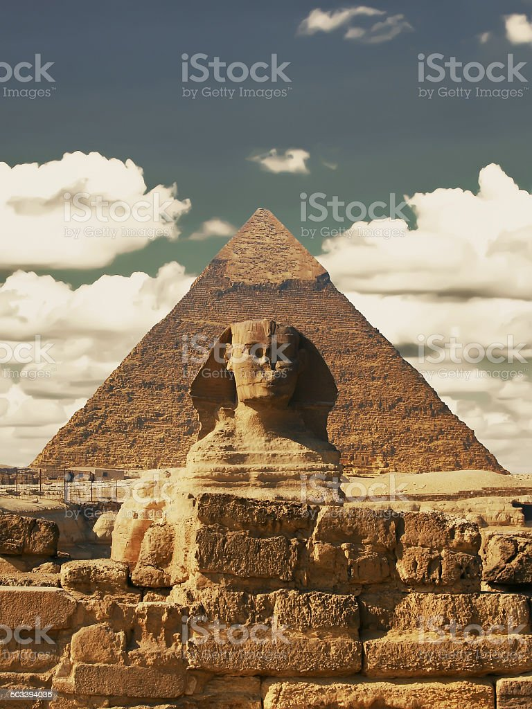 Beautiful profile of the Great Sphinx including pyramids stock photo