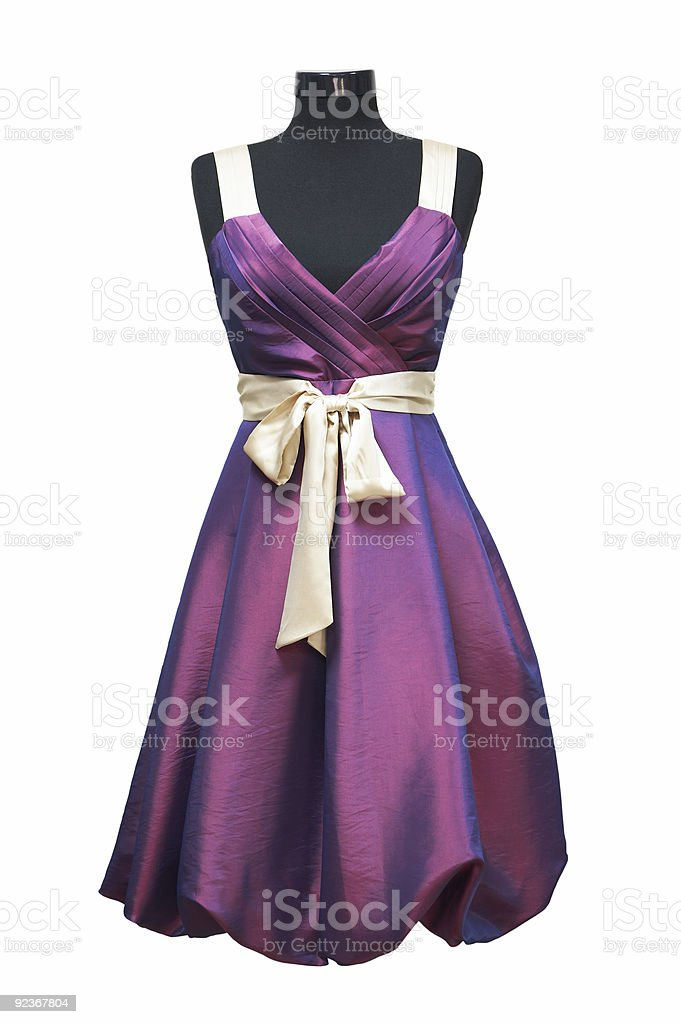 Beautiful purple dress with white bow on mannequin stock photo