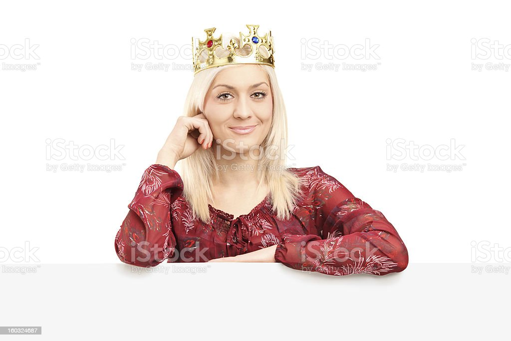 Beautiful queen with a diamond crown behind panel royalty-free stock photo