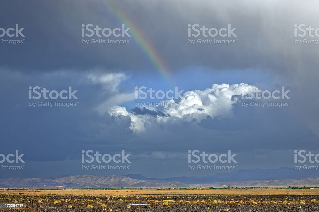 Beautiful Rainbow and Storm in Desert, Morocco Africa royalty-free stock photo