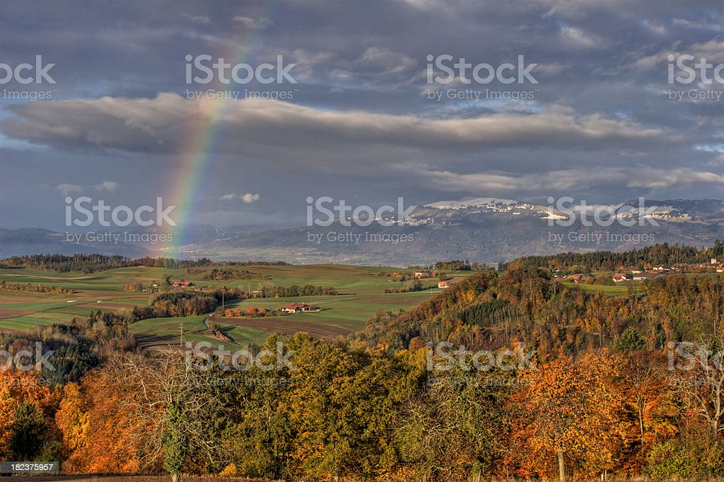 Beautiful rainbow over the Jura mountains in Vaud. royalty-free stock photo