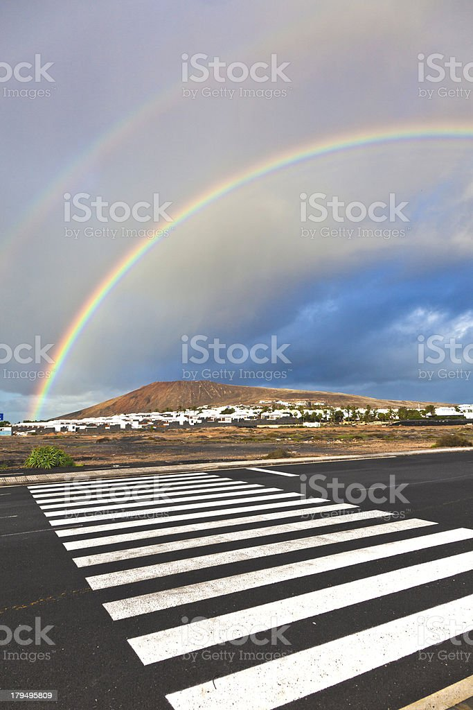 beautiful rainbow over the mountain with dark clouds royalty-free stock photo