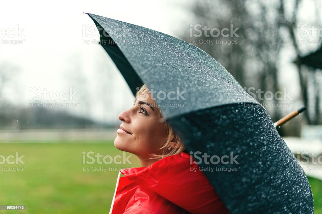 Shot of a pretty young lady holding an umbrella.