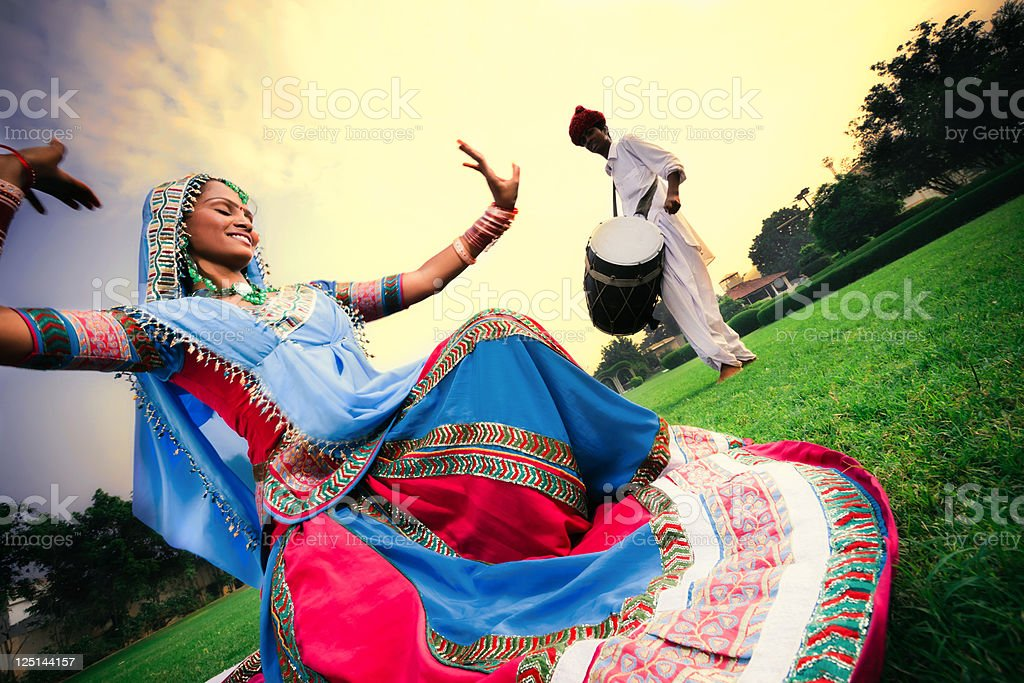 beautiful rajasthani girl dancing stock photo