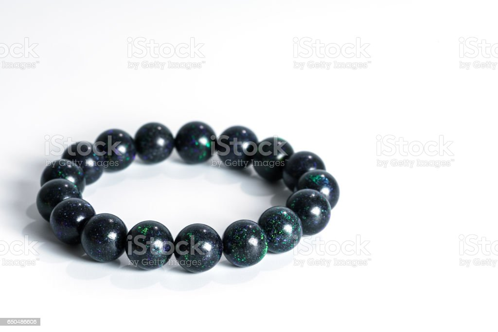 Beautiful rare Black Opal beads in bracelet on white background stock photo