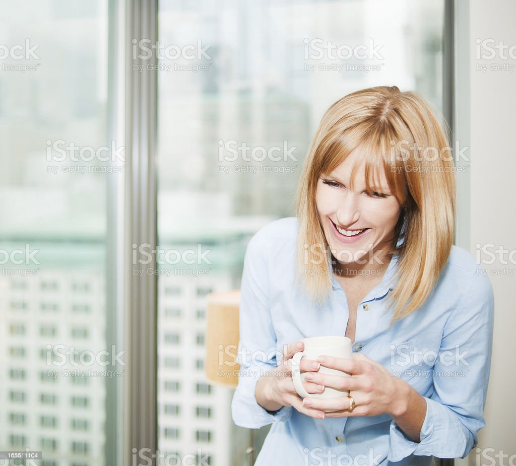 Beautiful Real Woman Relaxing in Condo royalty-free stock photo