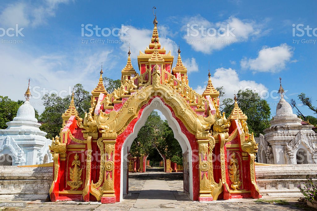 Beautiful red and gold gate at the Kuthodaw pagoda. royalty-free stock photo