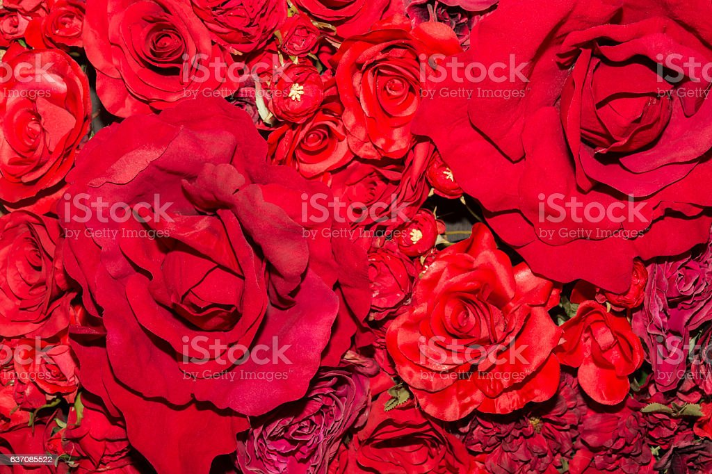 Beautiful red artificial flowers background. stock photo