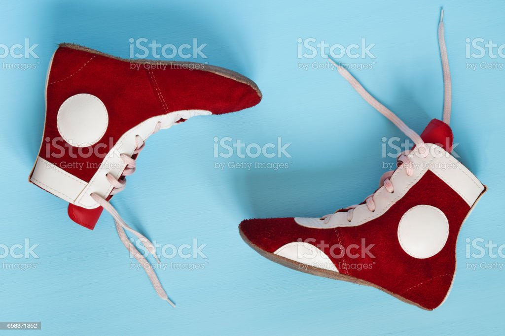 beautiful red athletic shoes on a blue floor stock photo