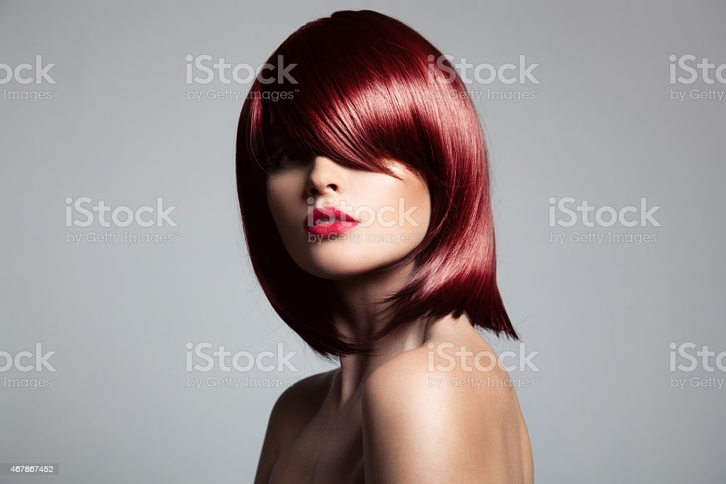 Beautiful red hair model with perfect glossy hair. stock photo