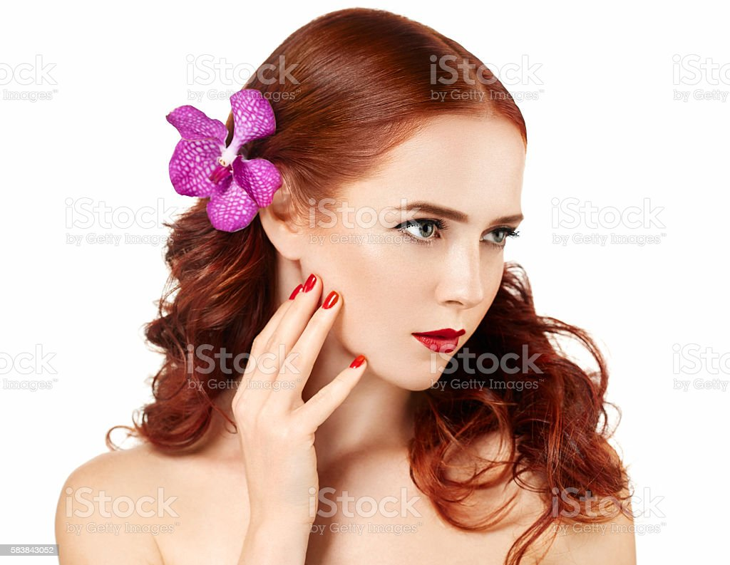 Beautiful red hair woman with flower portrait. Perfect make up stock photo