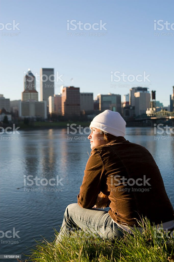 Beautiful Red Head Young Woman Enoying Downtown Waterfront Sunset, Copyspace royalty-free stock photo