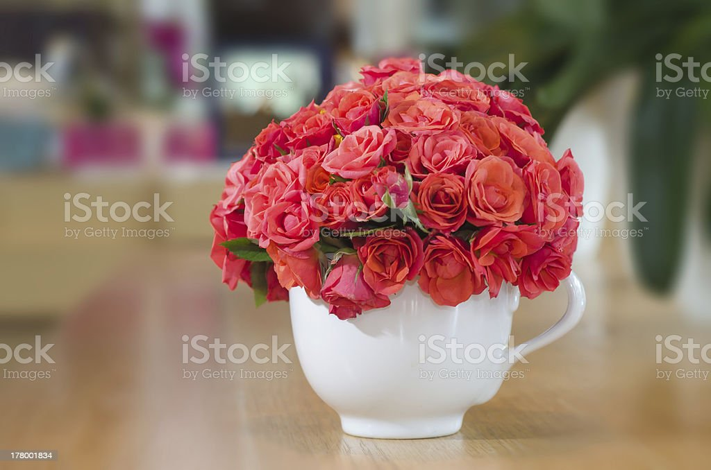 Beautiful red roses in vase on wooden table royalty-free stock photo