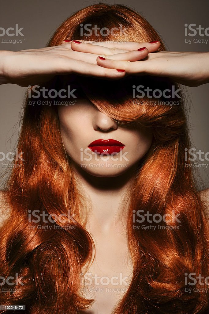 Beautiful Redhair Girl.Healthy Curly Hair. stock photo