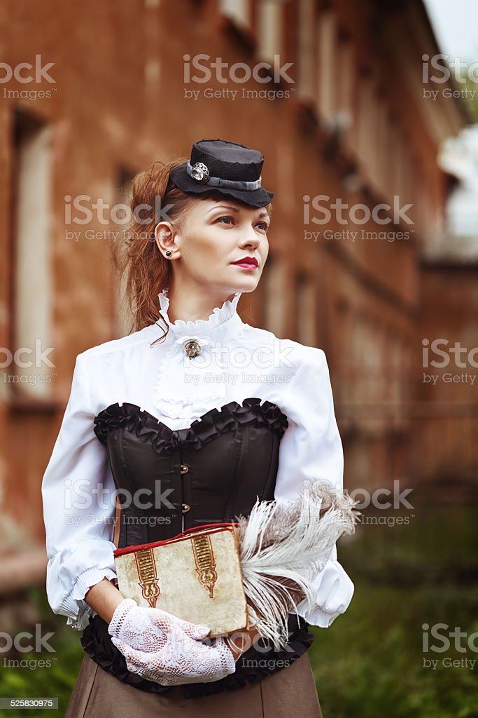 Beautiful redhair woman in vintage clothes stock photo