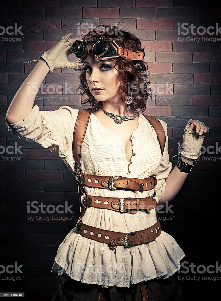 Beautiful redhair woman with steampunk goggles stock photo
