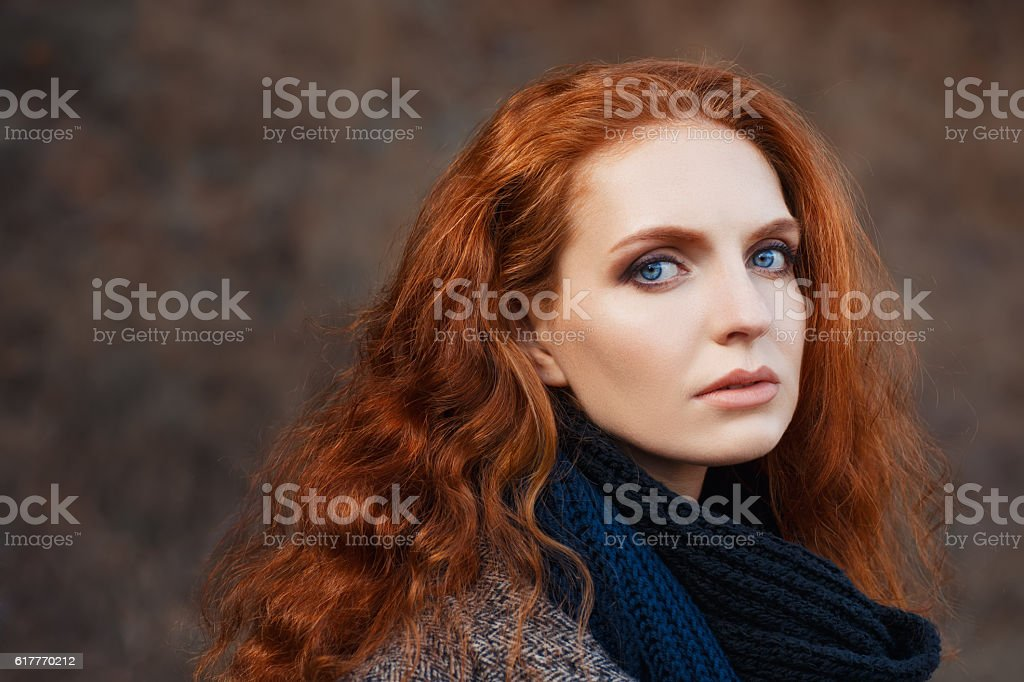 beautiful red-haired girl close-up stock photo