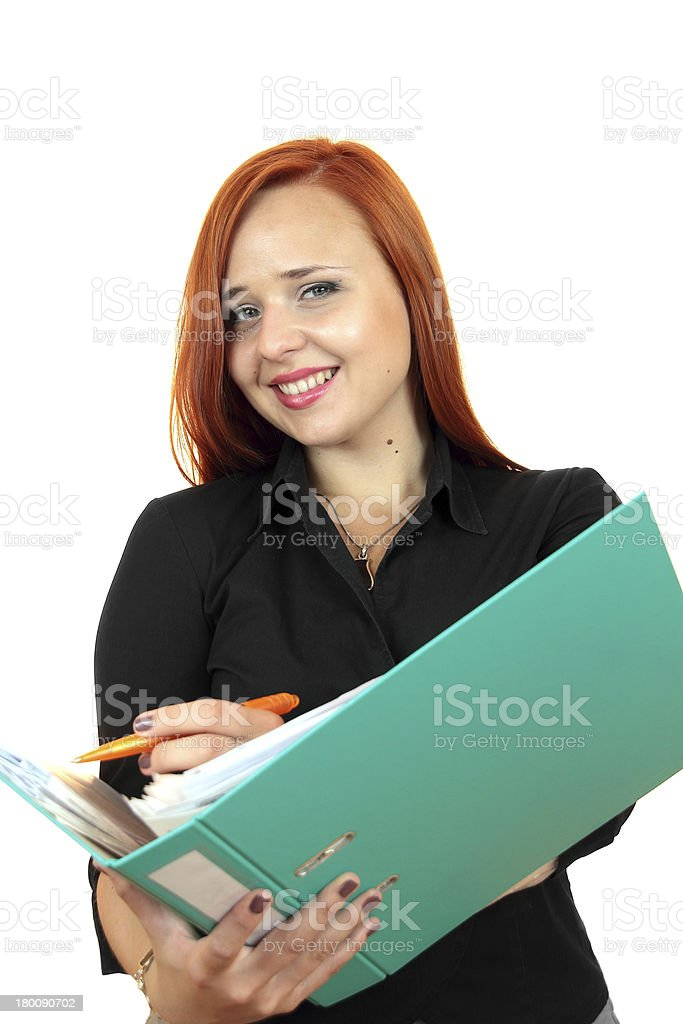 Beautiful redhead business woman with binder royalty-free stock photo