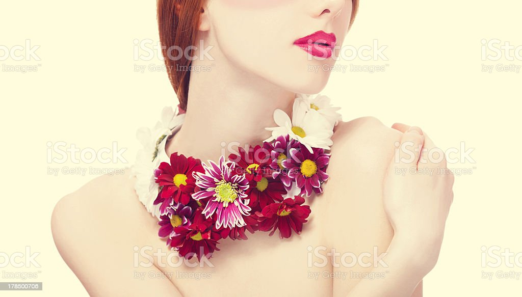 Beautiful redhead girl with flowers royalty-free stock photo