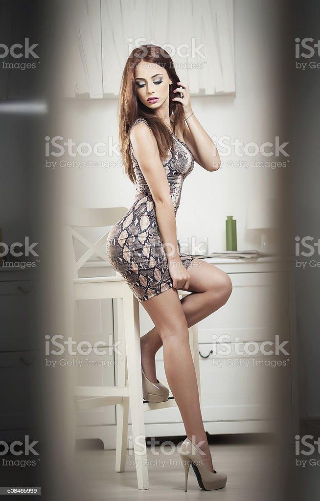 Beautiful redhead on high heels posing stock photo
