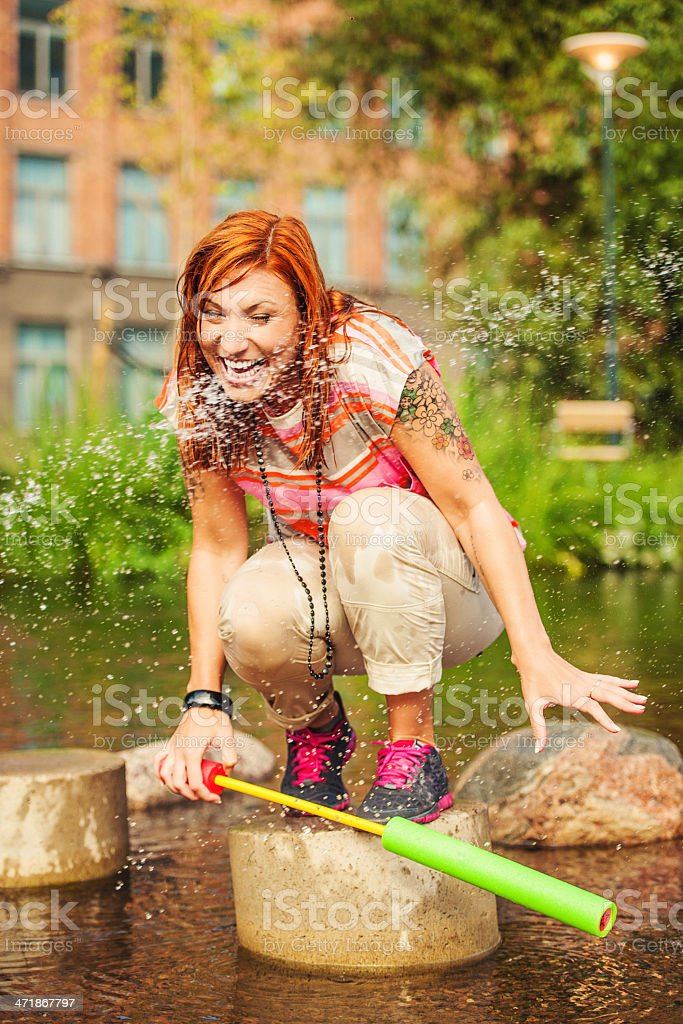 Beautiful redhead outdoors playing royalty-free stock photo