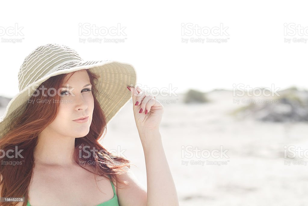 Beautiful redhead with a hat stock photo