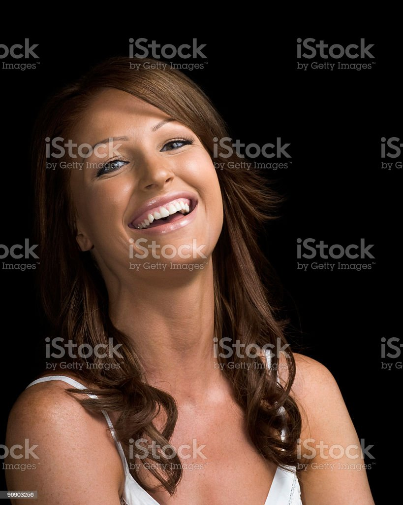Beautiful redhead woman in sundress laughing on black background royalty-free stock photo