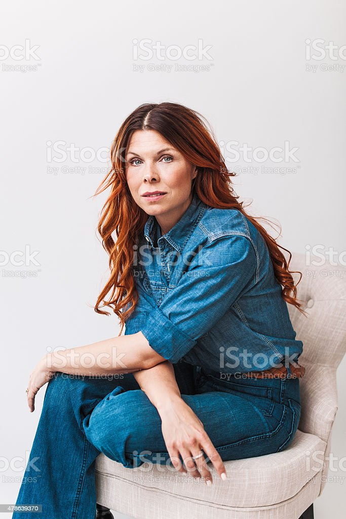 Beautiful redhead woman on her 40s stock photo