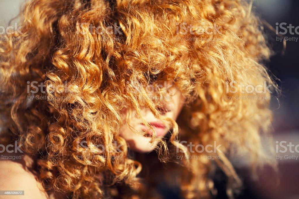 Beautiful redhead woman outdoors stock photo