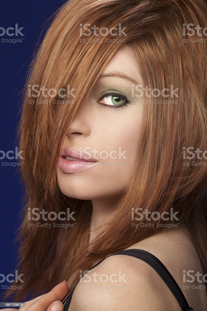 Beautiful Redhead Woman With Alluring Eyes stock photo