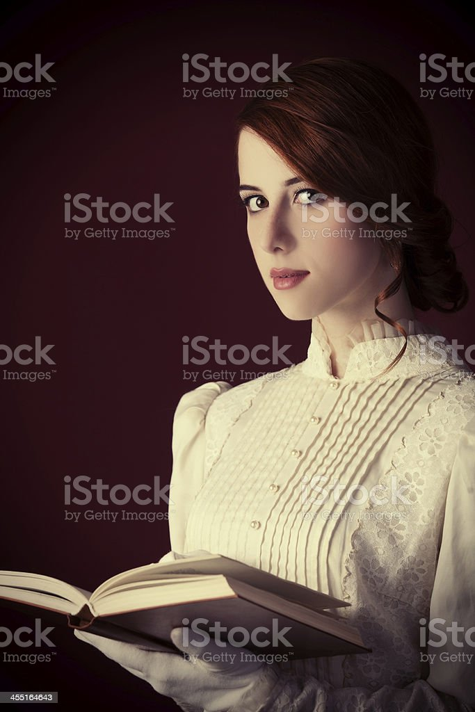 Beautiful redhead women with book stock photo
