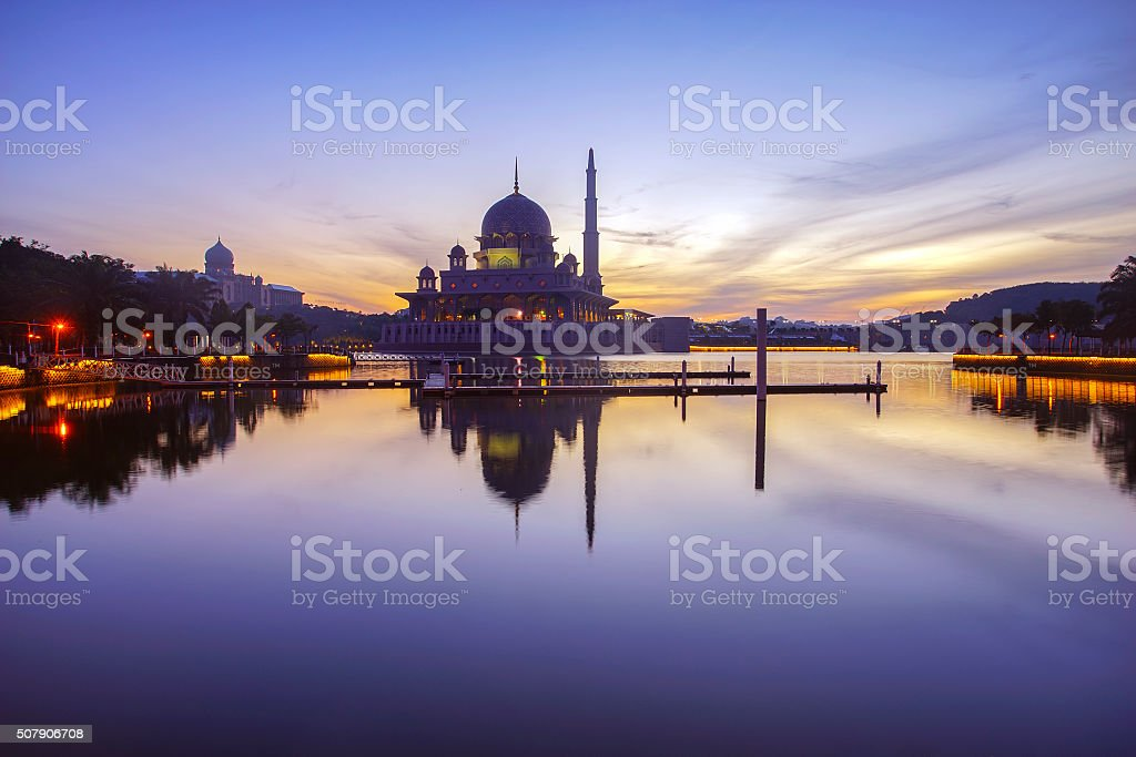 Beautiful reflection of Putra Mosque in lake during blue hour stock photo