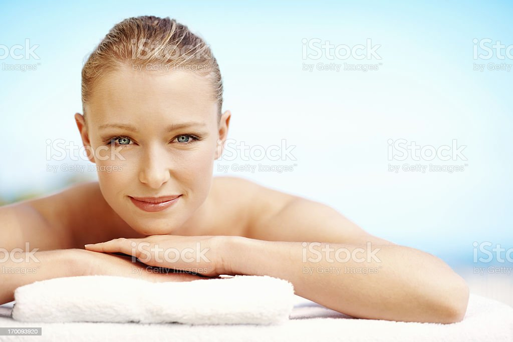 Beautiful relaxed woman lying on towel at spa royalty-free stock photo