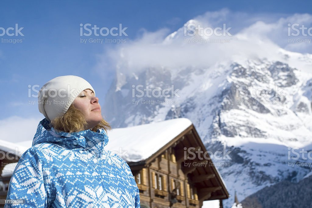 Beautiful relaxing young woman. Swiss alps at winter stock photo