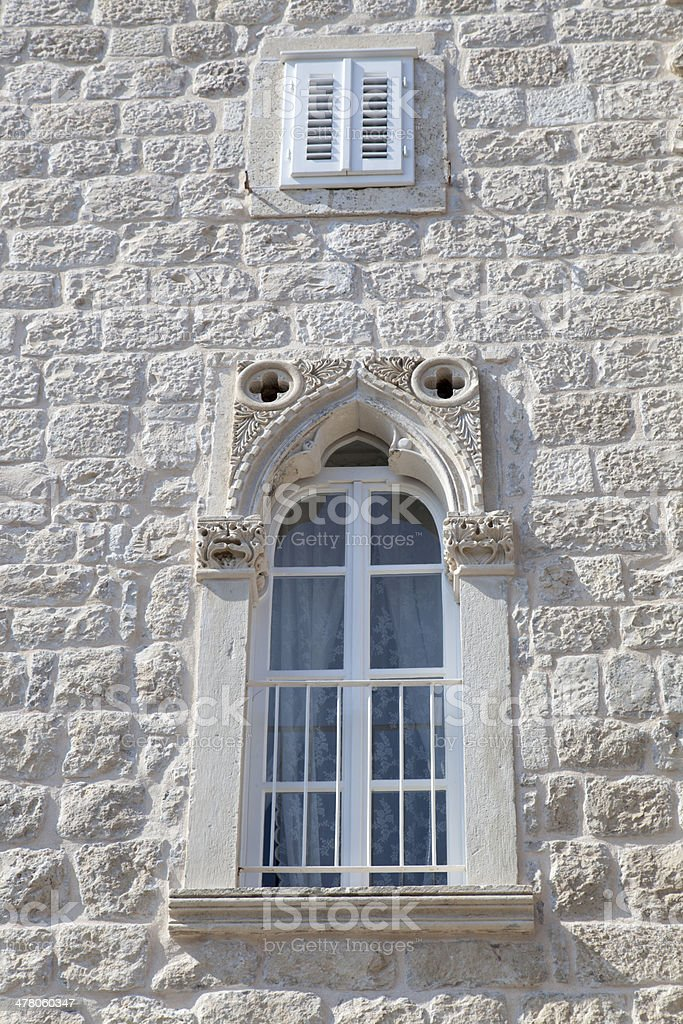 Beautiful renovated window in a stone house royalty-free stock photo