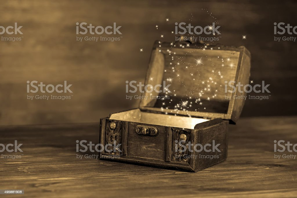 beautiful retro chest with miracle on wooden background stock photo