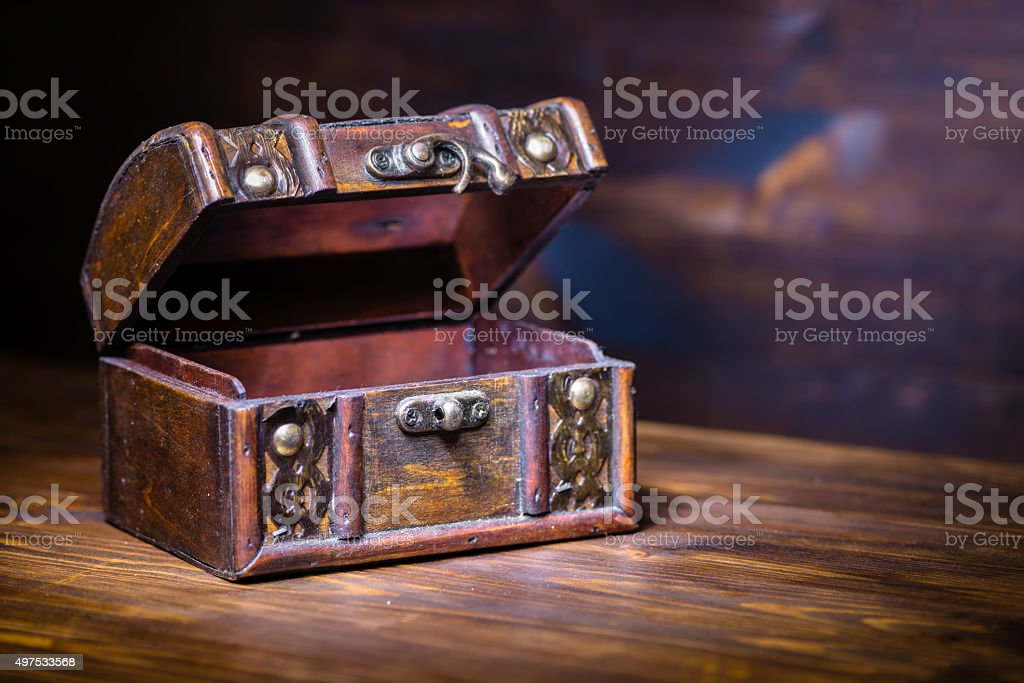 beautiful retro chest with open lid on wooden background stock photo