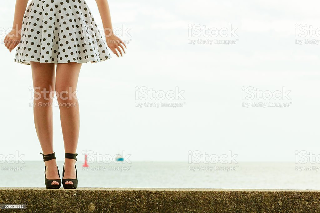 Beautiful retro style girl in polka dotted dress. stock photo