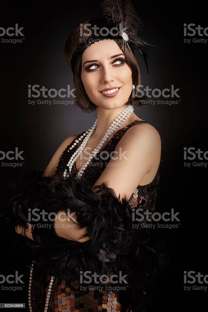 Beautiful retro woman from the roaring 20s ready to party stock photo