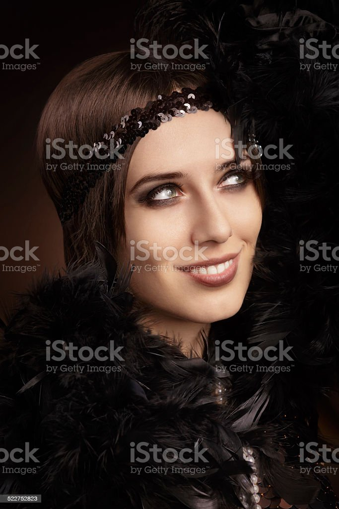 Beautiful retro woman in 20s style party outfit stock photo