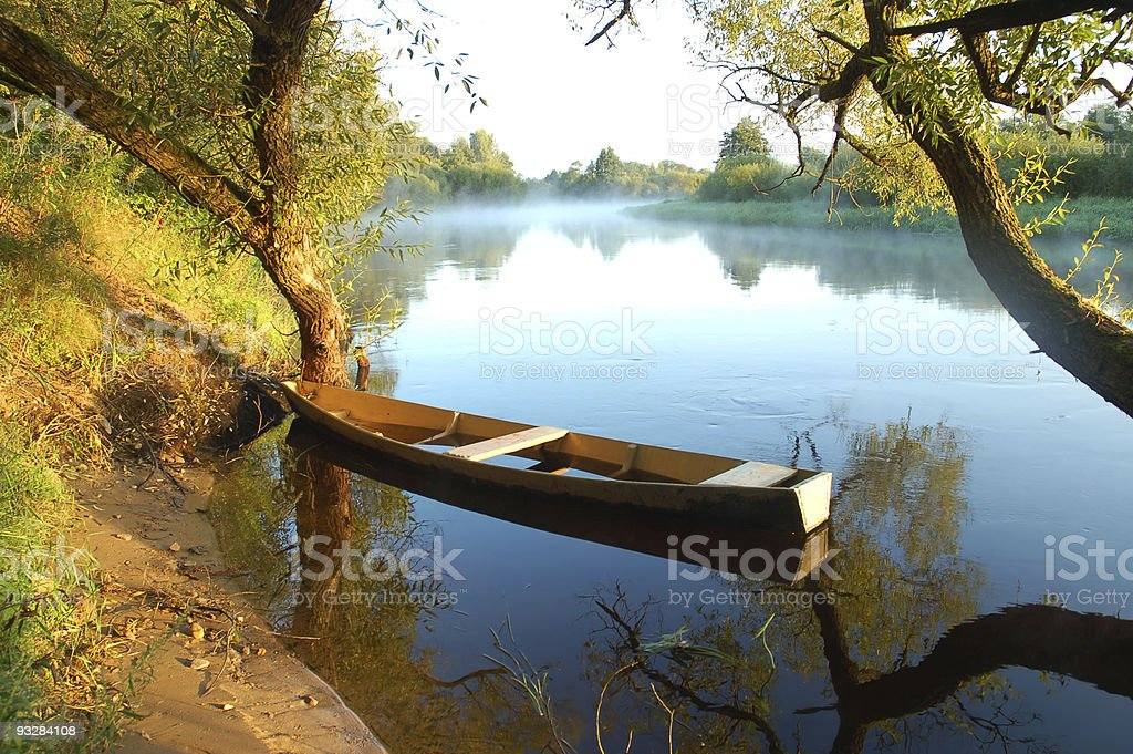 Beautiful river and yellow boat royalty-free stock photo