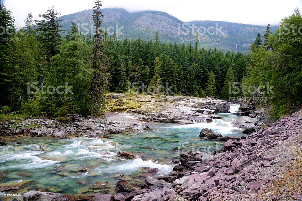 Beautiful river falls in Glacier National Park. stock photo