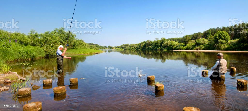 Beautiful river flowing in the countryside on a Sunny summer day stock photo
