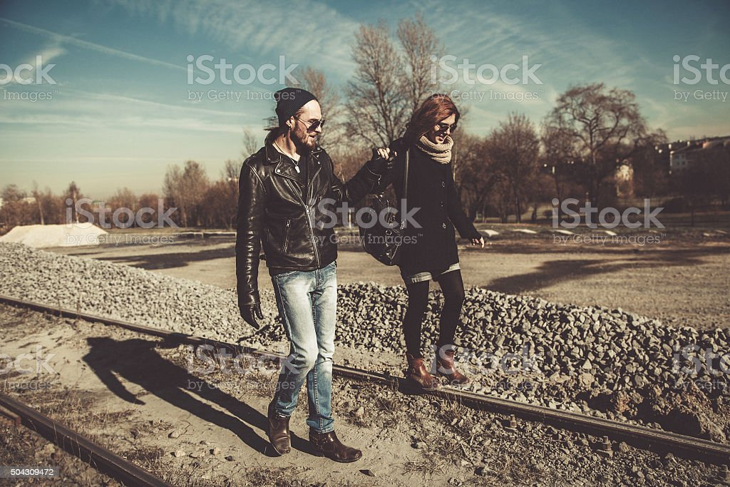 Beautiful rock and roll couple walking outdoors stock photo