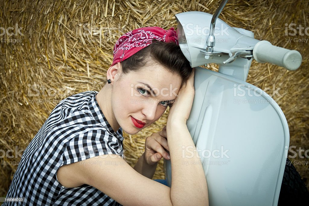 Beautiful rockabilly girl with vespa scooter royalty-free stock photo