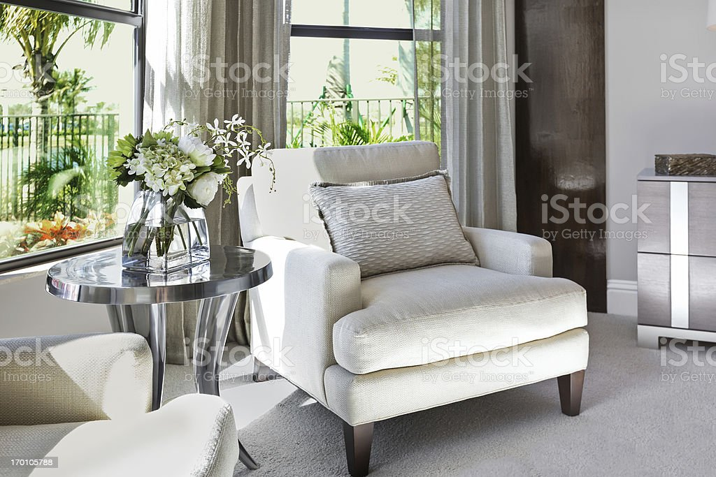 A beautiful, romantic bedroom sitting area with flowers..  stock photo