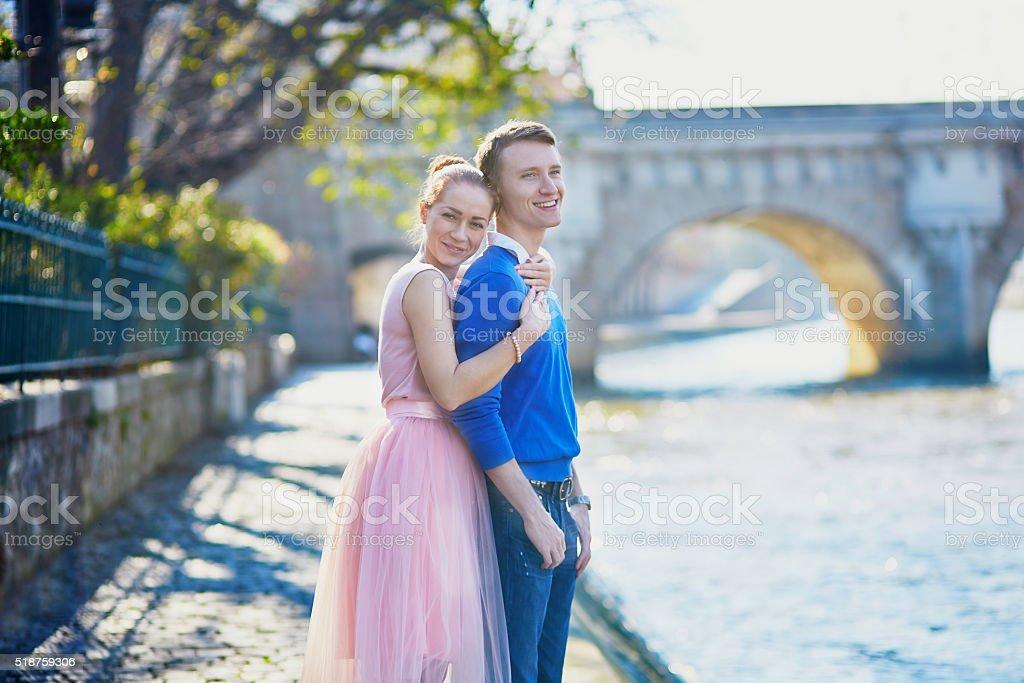 Beautiful romantic couple in Paris near the river Seine stock photo