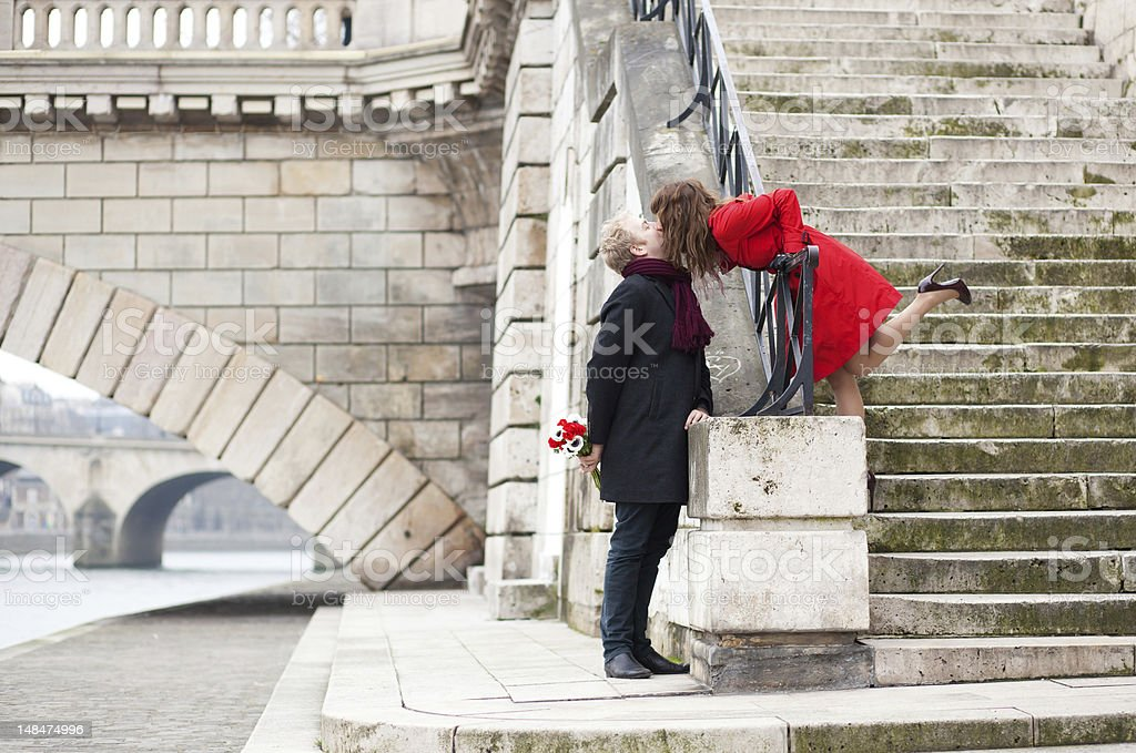 Beautiful romantic couple kissing on a Parisian embankment royalty-free stock photo